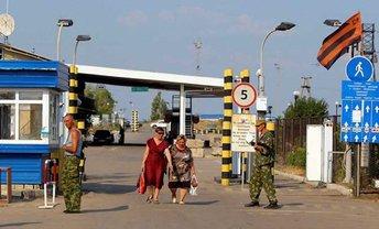 """Террористы требуют взятку за разрешение выезда из """"ДНР"""" - фото 1"""