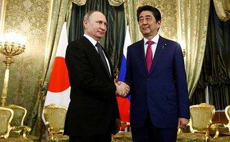 Путин и Абэ обсудили вопросы спорных территорий - фото 1