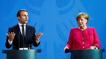 Макрон и Меркель обратились к Путину из-за ухода из СЦКК - фото 1