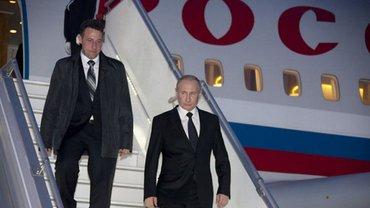 После австрийской свадьбы Путин прибыл на встречу с Меркель - фото 1