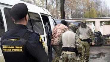 Террористы бросили 12 украинских моряков за решетку - фото 1