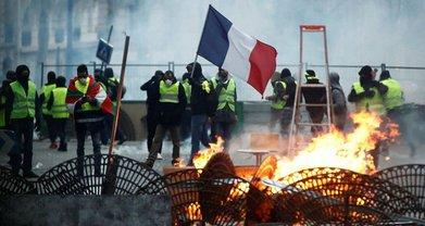 Протесты желтых жилетов: во Франции задержали почти 2000 человек - фото 1