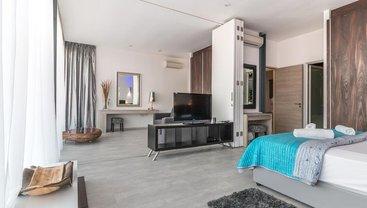Зонирование пространства спальни – от гардероба до гостиной - фото 1
