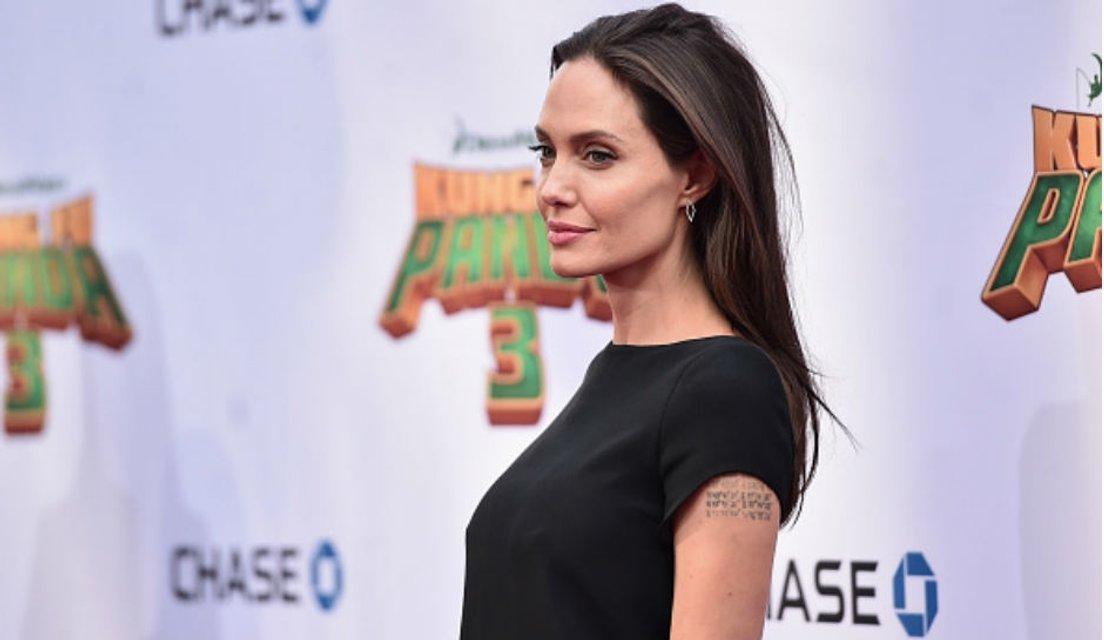 Брэд Питт и Анджелина Джоли не разводятся ради детей - фото 65272