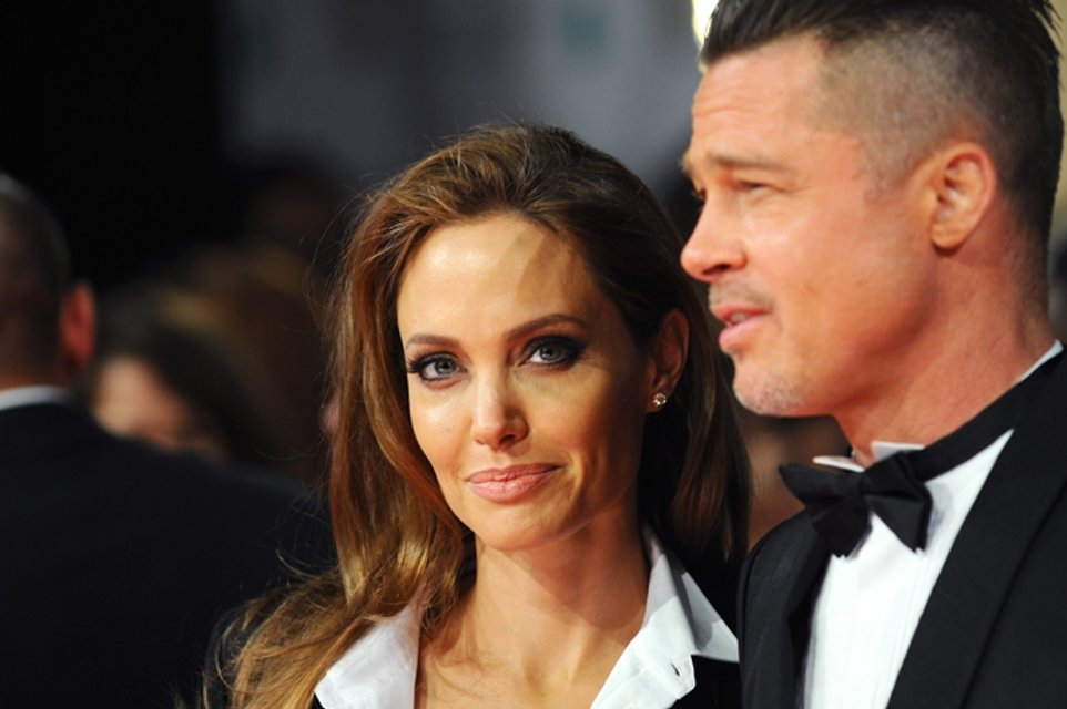 Брэд Питт и Анджелина Джоли не разводятся ради детей - фото 65278