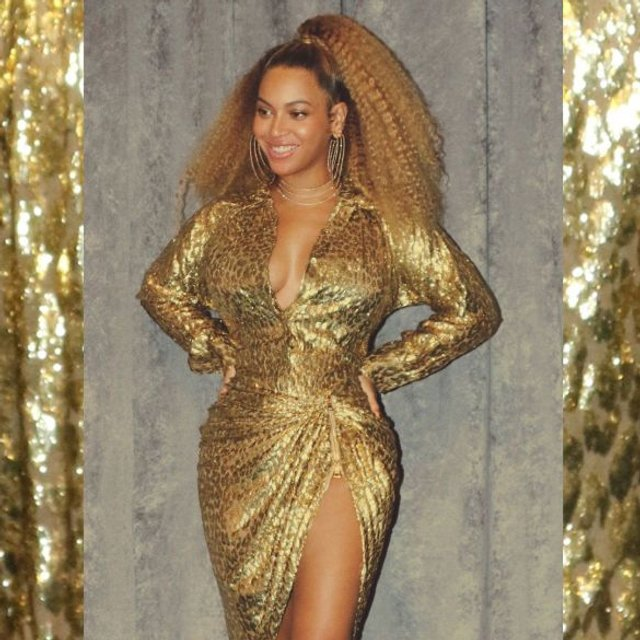 Бейонсе восхитила в золотом платье с глубоким декольте - фото 96906