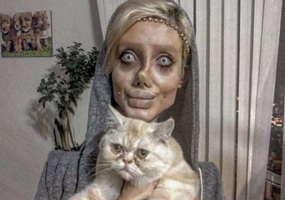 Вскрылся обман девушки-двойника Анджелины Джоли - фото 95926