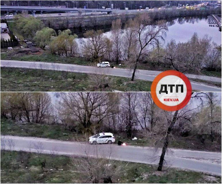 Под Дарницким мостом сняли полицейского, который сжигал документы (ФОТО) - фото 119928