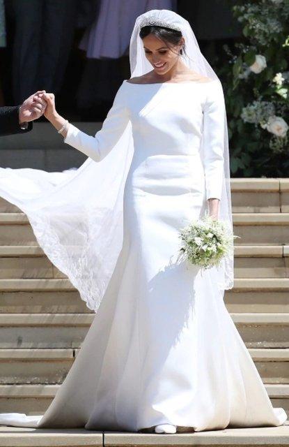 Виктория Бекхэм восхитилась нарядом Меган Маркл - фото 127318