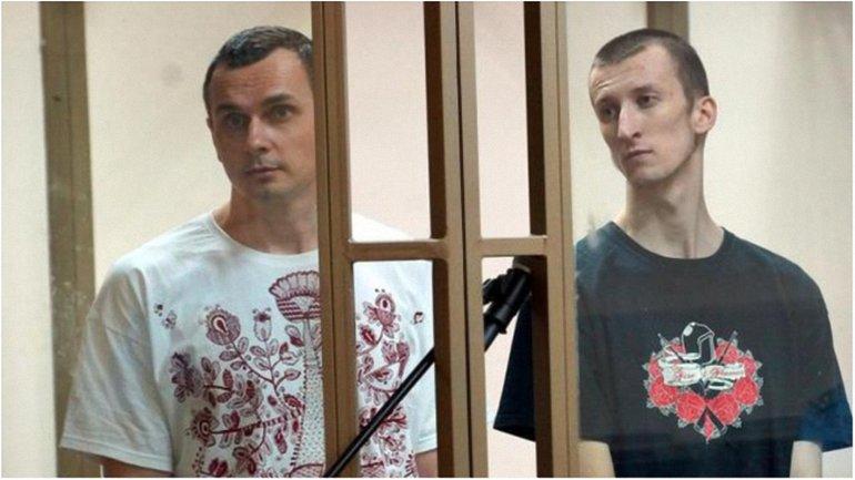 Незаконно осужденных в России Сенцову и Кольченко требуют немедленно отпустить - фото 1
