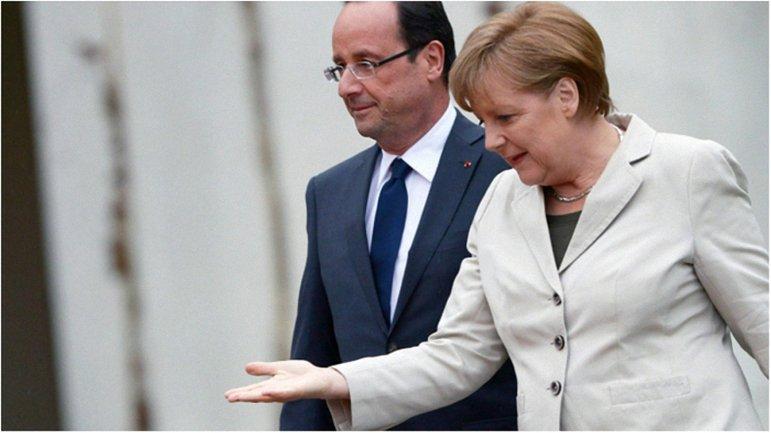 Меркель и Олланд пообещали совместно работать над стабилизацией ситуации в Крыму - фото 1