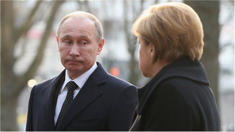 Путин провел телефонный разговор с Меркель - фото 1