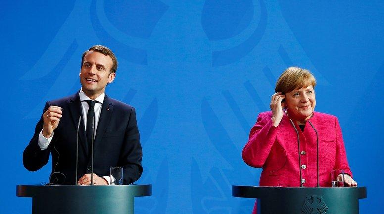 Меркель и Макрон сделали заявления по Донбассу - фото 1