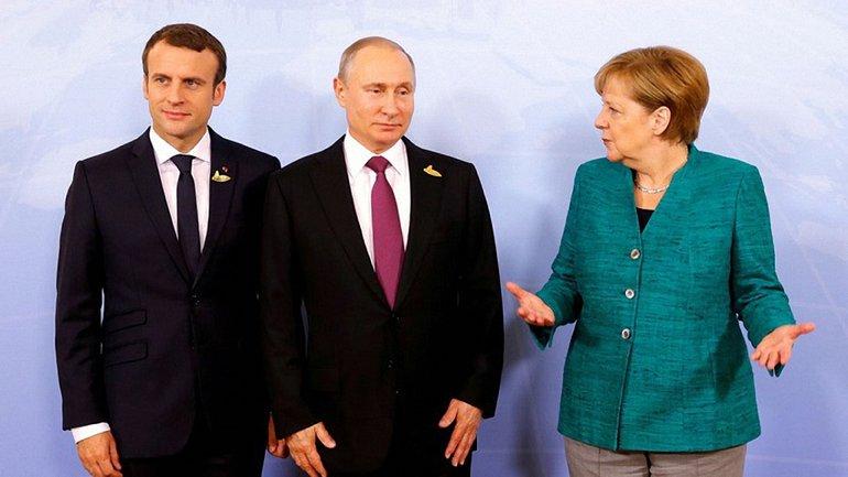 Эмманюэль Макрон, Владимир Путин и Ангела Меркель  - фото 1