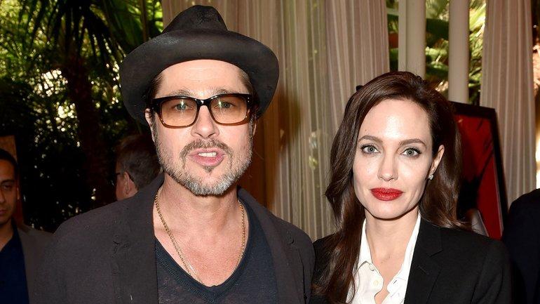 Анджелина Джоли и Брэд Питт не разводятся только ради детей - фото 1