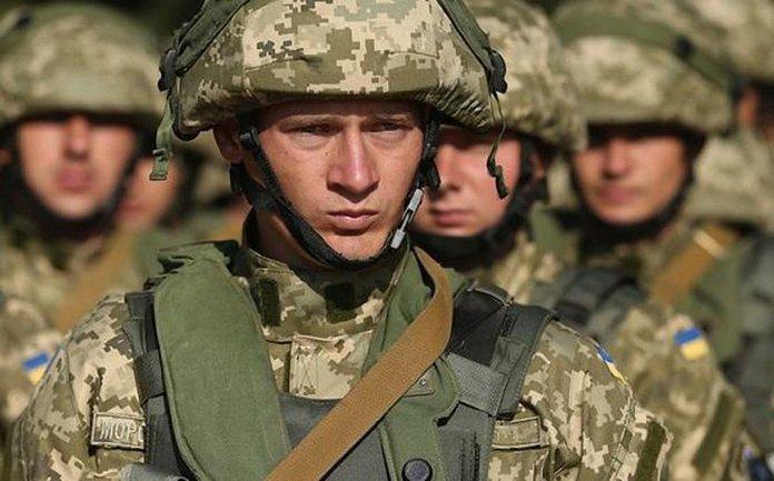 Украинские военные вели тяжелые бои в зоне АТО - фото 1