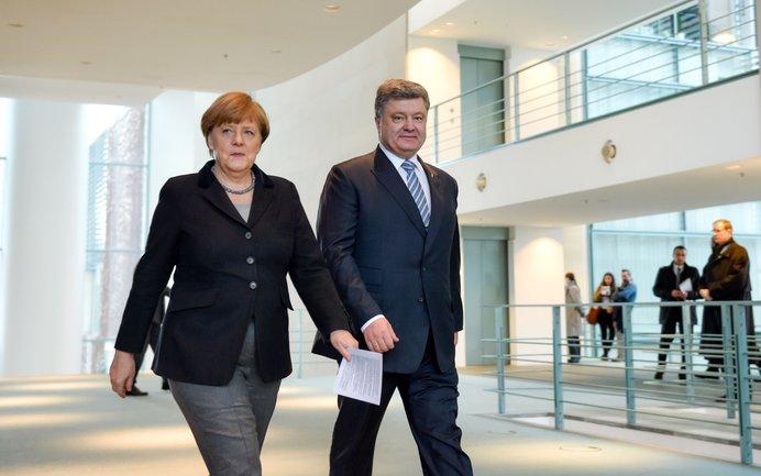 Порошенко назвал Меркель лидером мира и стабильности - фото 1