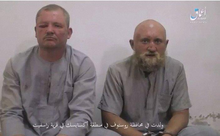 Боевики ИГИЛ взяли в плен россиян  - фото 1
