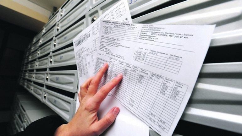 Украинцы не оплатили почти треть платежек за коммуналку в ноябре - фото 1