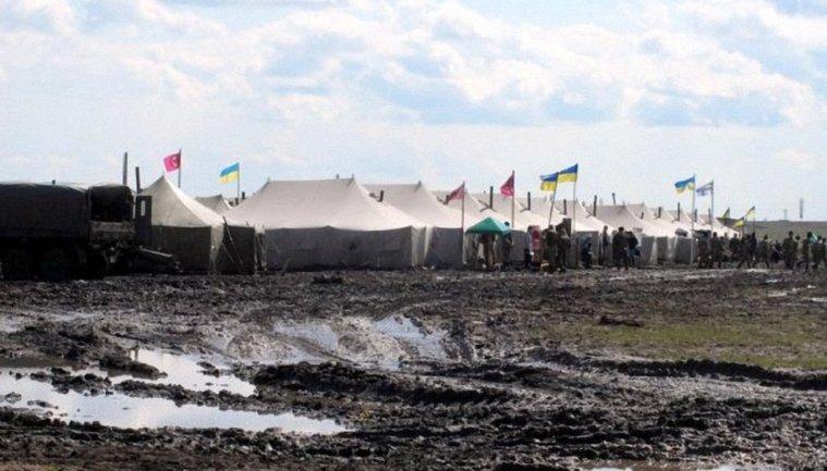 На полигоне ранен украинский военный - фото 1