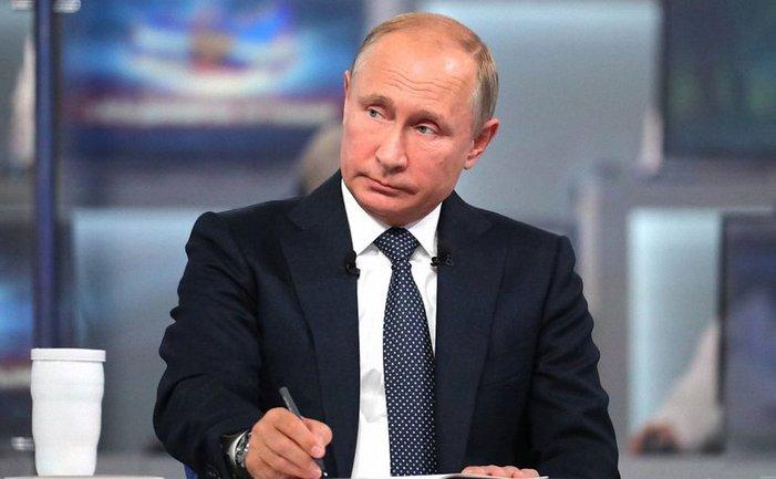 Ну ничего себе: портрет Путина в отеле Трампа - фото 1